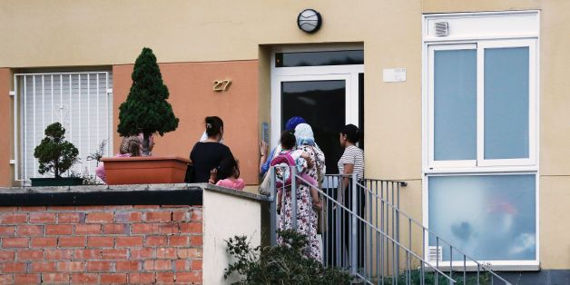 People ring the doorbell of the flat of the Oukabir family in Ripoll, after police carried out a search linked to the deadly terror attacks in Barcelona and the seaside resort of Cambrils on August 18, 2017, a day after a van ploughed into the crowd, killing 13 persons and injuring over 100 on the Rambla in Barcelona. 