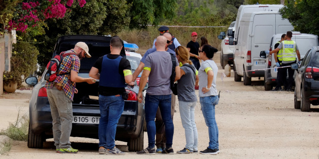 Police in plain clothes gather at the site where a house, which Barcelona attackers used to prepare the attacks, collapsed on Wednesday in Alcanar near Taragona, Spain August 20, 2017. REUTERS/Heino Kalis