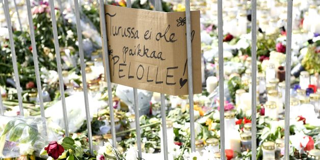 Candles, flowers and a placard reading 'There is no place for fear in Turku' have been left at the makeshift memorial for the victims of Friday's stabbings at the Turku Market Square, Finland on August 20, 2017.