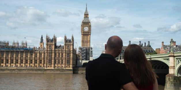 A couple hug agains the backdrop of the Elizabeth Tower, known as 'Big Ben' and the Houses of Parliament, in London on August 14, 2017. The bongs of the iconic bell will be stopped to protect workers during a four-year, £29m-conservation project that includes repair of the Queen Elizabeth Tower, which houses the Great Clock and its bell. The familiar bongs will fall silent after sounding at noon 21 August, and are set to begin again regularly in 2021. (Photo by Alberto Pezzali/NurPhoto via Ge