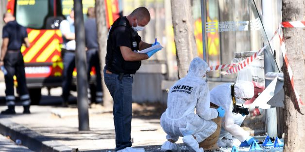 French forensic police search the site following a car crash on August 21, 2017, in the southern Mediterranean city of Marseille.  At least one person has died in Marseille after a car crashed into people waiting at two different bus stops in the southern French port city, police sources told AFP, adding that the suspected driver had been arrested afterwards. The police sources, who asked not to be identified, did not say whether the incident was being treated as a terror attack or an accident.