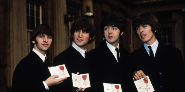 The Beatles (l to r) Ringo Starr, John Lennon, Paul McCartney, and George Harrison show off their MBE medals after their investiture at Buckingham Palace. (Photo by © Hulton-Deutsch Collection/CORBIS/Corbis via Getty Images)