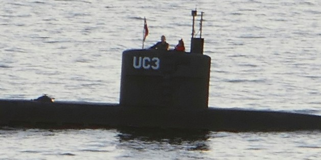 Allegedly Swedish journalist Kim Wall stands next to a man in the tower of the private submarine 'UC3 Nautilus' on August 10, 2017 in Copenhagen Harbor. 