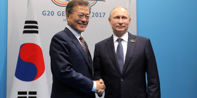 HAMBURG, GERMANY - JULY 7, 2017: South Korea's President Moon Jae-in (L) and Russia's President Vladimir Putin shake hands during a meeting on the sidelines of a G20 summit. Mikhail Klimentyev/Russian Presidential Press and Information Office/TASS (Photo by Mikhail Klimentyev\TASS via Getty Images)