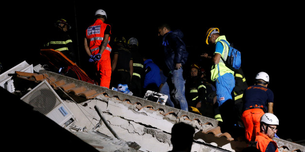 Rescue workers check a collapsed house after an earthquake hits the island of Ischia, off the coast of Naples, Italy August 22, 2017. REUTERS/Ciro De Luca