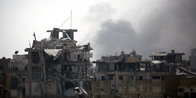 Smoke billows in an eastern area of the embattled northern Syrian city of Raqa on August 15, 2017, as Syrian Democratic Forces (SDF), a US backed Kurdish-Arab alliance, battle to retake the city from the Islamic State (IS) group.  / AFP PHOTO / DELIL SOULEIMAN        (Photo credit should read DELIL SOULEIMAN/AFP/Getty Images)