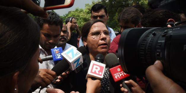Indian Supreme Court advocate Farha Faiz (C) speaks to the media outside the Supreme Court in New Delhi on August 22, 2017.India's top court on August 22 banned a controversial Islamic practice that allows men to divorce their wives instantly, ending a long tradition that many Muslim women had fiercely opposed. / AFP PHOTO / Money SHARMA        (Photo credit should read MONEY SHARMA/AFP/Getty Images)