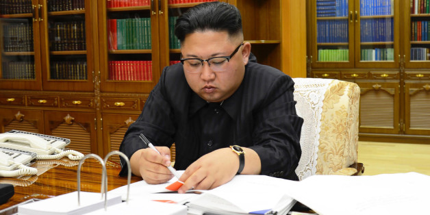 This picture from North Korea's official Korean Central News Agency (KCNA) taken on July 3, 2017 and released on July 4, 2017 shows North Korean leader Kim Jong-Un signing the order to carry out the test-fire of the intercontinental ballistic missile Hwasong-14 at an undisclosed location.North Korea declared on July 4 it had successfully tested its first intercontinental ballistic missile -- a watershed moment in its push to develop a nuclear weapon capable of hitting the mainland United States.