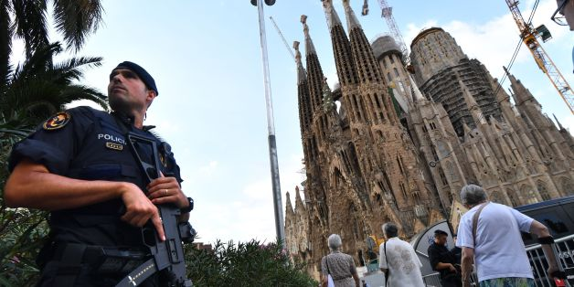 TOPSHOT - A police officer stands by the Sagrada Familia basilica in Barcelona on August 20, 2017, before a mass to commemorate victims of two devastating terror attacks in Barcelona and Cambrils.A grief-stricken Barcelona prepared today to commemorate victims of two devastating terror attacks at a mass in the city's Sagrada Familia church. As investigators scrambled to piece together the attacks which killed 14 people in all, Interior Minister Juan Ignacio Zoido said on August 19 the cell behin