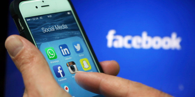 Social media apps including WhattsApp, LinkedIn, Twitter, FaceBook, Instagram, SnapChat and Periscope are displayed in a social media folder on the screen of an Apple Inc. iPhone 6 in this arranged photograph taken in London, U.K., on Friday, May, 15, 2015. Facebook Inc. reached a deal with New York Times Co. and eight other media outlets to post stories directly to the social network's mobile news feeds, as publishers strive for new ways to expand their reach. Photographer: Chris Ratcliffe/Bloo