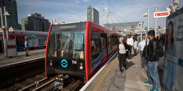 A Docklands Light Railway (DLR) arrives at Poplar station in London, U.K., on Monday, Aug. 14, 2017. The Docklands Light Railway, a low-capacity rail system connecting the City of London to the Docklands area that carries 122 million passengers a year, began operating on Aug. 31, 1987. Photographer: Simon Dawson/Bloomberg via Getty Images