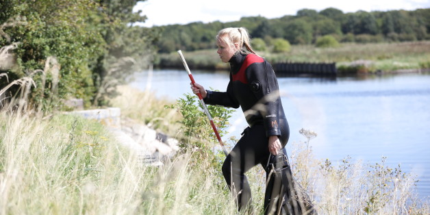 Members of The Danish Emergency Management Agency (DEMA) assist police at Kalvebod Faelled in Copenhagen on August 23, 2017 in search of missing bodyparts of journalist Kim Wall close to the site where her torso was found on, August 21. / AFP PHOTO / Scanpix Denmark / Martin Sylvest / Denmark OUT        (Photo credit should read MARTIN SYLVEST/AFP/Getty Images)