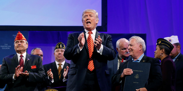 U.S. President Donald Trump applauds after signing the Veterans Appeals Improvement and Modernization Act during the American Legion National Convention in Reno, Nevada, U.S., August 23, 2017.   REUTERS/Joshua Roberts