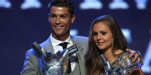 Real Madrid's Portuguese forward Cristiano Ronaldo (L) poses the trophy after he was awarded the title of 'Best Men's Player in Europe' while standing alongside ' Best Womans player in Europe' Netherlands Lieke Martens at the conclusion of the UEFA Champions League group stage draw ceremony in Monaco on August 24, 2017.  / AFP PHOTO / VALERY HACHE        (Photo credit should read VALERY HACHE/AFP/Getty Images)