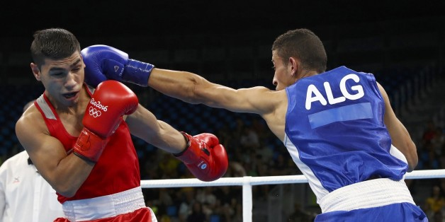 2016 Rio Olympics - Boxing - Preliminary - Men's Fly (52kg) Round of 16 Bout 207 - Riocentro - Pavilion 6 - Rio de Janeiro, Brazil - 15/08/2016. Daniel Asenov (BUL) of Bulgaria and Mohamed Flissi (ALG) of Algeria compete. REUTERS/Yves Herman  FOR EDITORIAL USE ONLY. NOT FOR SALE FOR MARKETING OR ADVERTISING CAMPAIGNS.