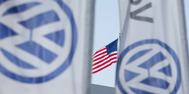 FILE PHOTO - An American flag flies next to a Volkswagen car dealership in San Diego, California, U.S. September 23, 2015.   REUTERS/Mike Blake/File Photo