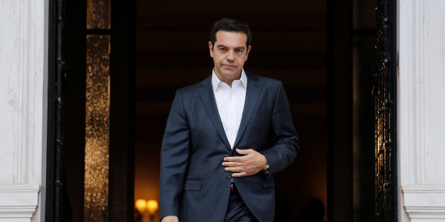 Greek Prime Minister Alexis Tsipras waits to welcome his Turkish counterpart Binali Yildirim at the Maximos Mansion in Athens, Greece June 19, 2017. REUTERS/Costas Baltas