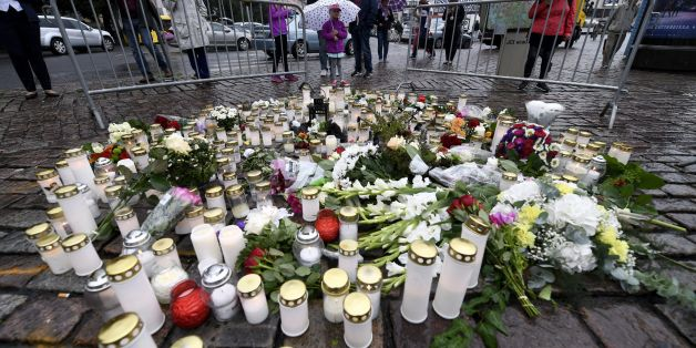 People light memorial candles at the Turku Market Square for the victims of a stabbing spree on August 19, 2017 in Turku.