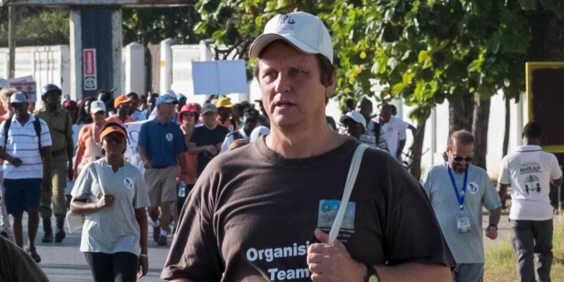 A picture taken on January 14, 2017, shows South African conservationist Wayne Lotter taking part in the Walk for Elephants event endorsed by the Chinese embassy, in Dar es Salaam.Lotter, a leading conservationist who had worked hard to bring down notorious elephant poachers and stop ivory-trafficking, has been shot dead in Tanzania, his PAMS foundation said on August 20, 2017. The motive for the killing of the South African was unknown.  / AFP PHOTO / Daniel Hayduk        (Photo credit should r