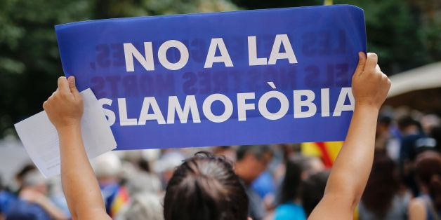 A woman holds a placard reading in Catalan 'No to Islamophobia' prior to a march against terrorism which slogan will be #NoTincPor (I'm Not Afraid) in Barcelona on August 26, 2017, following the Barcelona and Cambrils attacks killing 15 people and injuring over 100.Tens of thousands of Spaniards and foreigners are to stage a defiant march against terror through Barcelona on August 26 following last week's deadly vehicle rampages.The Mediterranean city is in mourning after a van ploughed into cro