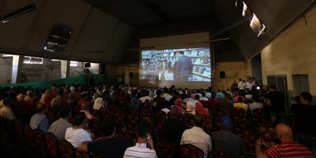 "Palestinians attend the screening of ""10 Years"" at Samer Cinema in Gaza City on August 26, 2017. The Samer Cinema in Gaza City, the oldest in the strip and was built in 1944 but closed for decades, hosted a special screening of a film about Palestinians in Israeli prisons.  (Photo by Majdi Fathi/NurPhoto via Getty Images)"