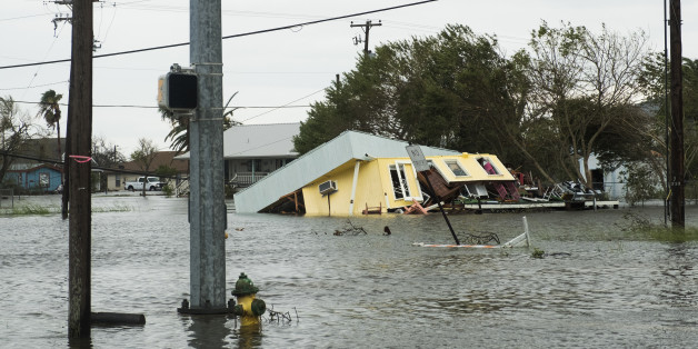 Flooding and a damaged home are seen after Hurricane Harvey hit Rockport, Texas, U.S., on Saturday, Aug. 26, 2017. As Harvey's winds die down, trouble for Texas has just begun as days of flooding rains across the heart of U.S. energy production threaten the country's fourth-largest city and leave farmers struggling to save horses, cows and crops. Photographer: Alex Scott/Bloomberg via Getty Images