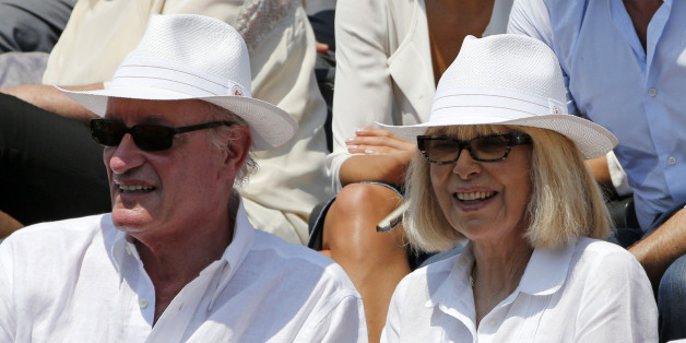 French actress Mireille Darc (R) and her husband Pascal Desprez watch the men's semi-final match between Jo-Wilfried Tsonga of France and Stan Wawrinka of Switzerland during the French Open tennis tournament at the Roland Garros stadium in Paris, France, June 5, 2015.            REUTERS/Jean-Paul Pelissier