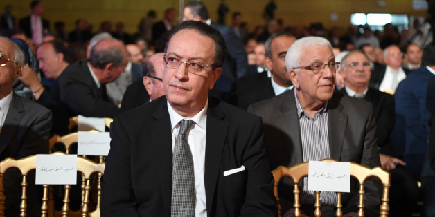 Hafedh Caid Essebsi (C), leader of Nidaa Tounes party, looks on as he attends an official speech delivered by the Tunisian President Beji Caid Essebsi (unseen) on May 10, 2017 in Tunis. Essebsi said that the army will protect the output of Tunisia's main resources from being disrupted by protests over social and labour issues. / AFP PHOTO / FETHI BELAID        (Photo credit should read FETHI BELAID/AFP/Getty Images)