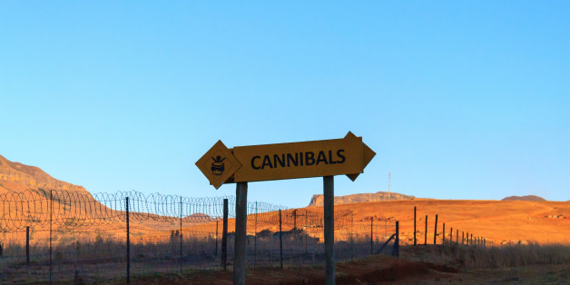 Cannibals road sign on the road to Drakensberg mountains, South Africa.