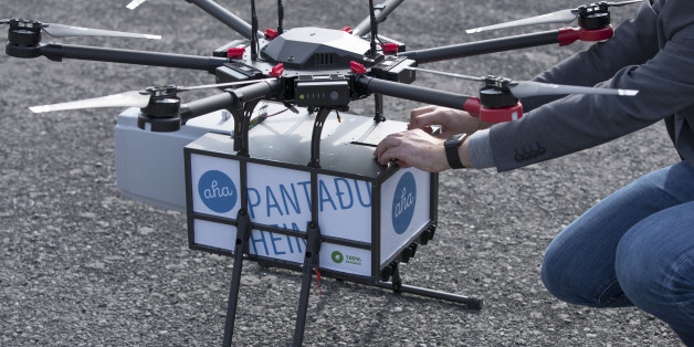 Maron Kristofersson, chief executive officer of Aha, handles a package secured to a drone manufactured by Flytrex in Reykjavík, Iceland, on Friday, Aug. 25, 2017. Flytrexs drones will fly more than 2.5 kilometers (1.6 mile) across a large bay that separates two parts of the city, delivering for online marketplace Aha. Photographer: Arnaldur Halldorsson/Bloomberg via Getty Images
