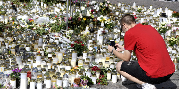 Mourners bring memorial cards, candles and flowers to the Turku Market Square, in Turku, Finland August 20, 2017. Lehtikuva/Vesa Moilanen/via ATTENTION EDITORS - THIS IMAGE WAS PROVIDED BY A THIRD PARTY. FINLAND OUT.