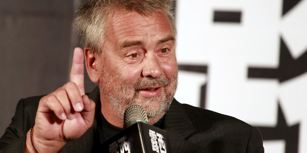 """French film director Luc Besson gestures while answering a question during a news conference to promote his latest movie """"Lucy"""" in Taipei August 19, 2014. Besson, whose new film """"Lucy"""" is about a woman who ingests a drug that gives her supernormal mental powers, says action films bore him - but his movie still has a spectacular car chase through Paris.  REUTERS/Pichi Chuang (TAIWAN - Tags: ENTERTAINMENT)"""