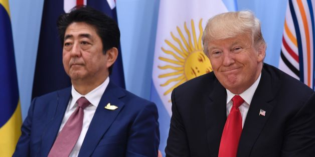 US President Donald Trump (R) and Japan's Prime Minister Shinzo Abe attend the panel discussion  'Launch Event Women's Entrepreneur Finance Initiative' on the second day of the G20 Summit in Hamburg, Germany, July 8, 2017.Leaders of the world's top economies gather from July 7 to 8, 2017 in Germany for likely the stormiest G20 summit in years, with disagreements ranging from wars to climate change and global trade. / AFP PHOTO / SAUL LOEB        (Photo credit should read SAUL LOEB/AFP/Getty Imag