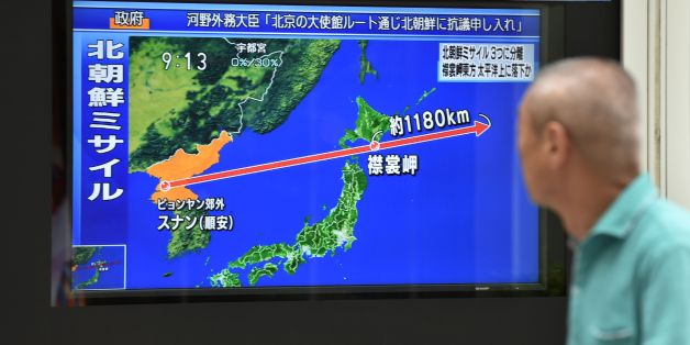 A pedestrian looks at a television screen displaying a map of Japan (R) and the Korean Peninsula in Tokyo on August 29, 2017, following a North Korean missile test that passed over Japan.Japan's Prime Minister Shinzo Abe on August 29 said North Korea's launch of a missile over its territory was an 'unprecedented, serious and grave threat' as he called for an emergency UN Security Council meeting. / AFP PHOTO / Kazuhiro NOGI        (Photo credit should read KAZUHIRO NOGI/AFP/Getty Images)