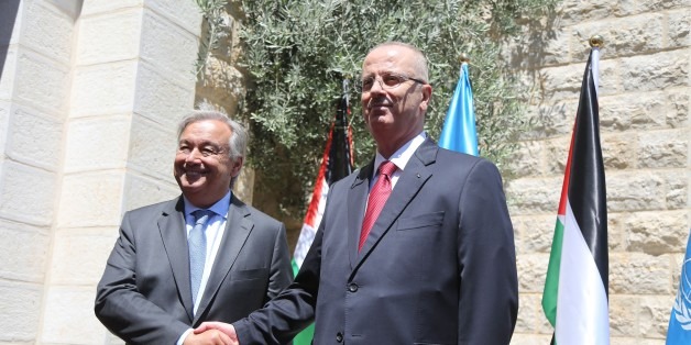 RAMALLAH, WEST BANK - AUGUST 29: United Nations Secretary General Antonio Guterres (L) shakes hands with Prime Minister of Palestine Rami Hamdallah (R) as they pose for a photo during an official ceremony at Prime Ministry building due to Guterres' official visit in Ramallah, West Bank on August 29, 2017. (Photo by Issam Rimawi/Anadolu Agency/Getty Images)