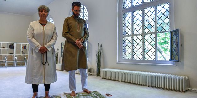Openly gay French imam Ludovic-Mohamed Zahed (R) and German-Turkish lawyer, author and activist Seyran Ates (L) pose for photographers prior to Friday prayers at the Ibn Rushd-Goethe-mosque in Berlin on July 28, 2017.Zaher, who opened the first gay-friendly mosque in France in 2012, visited the Ibn Rushd-Goethe-mosque founded by Seyran Ates, which aims to establish a humanistic, secular and liberal reading of Islam. / AFP PHOTO / John MACDOUGALL        (Photo credit should read JOHN MACDOUGALL/A