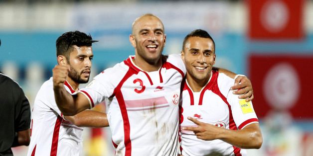 Football Soccer - Tunisia v Guinea - World Cup 2018 Qualifier - Monastir's Olympic Stadium Mustapha Ben Jannet Monastir, Tunisia - 9/10/16. Tunisia's Aymen Abdennour and  Anis Ben Hatira celebrate after scoring. REUTERS/Zoubeir Souissi