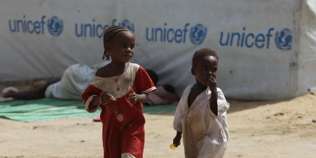 N'DJAMENA, CHAD - JUNE 21: Children  outside the tents in a refugee camp near the capital  N'Djamena, Chad on June 21, 2015. (Photo by Orhan Cicek/Anadolu Agency/Getty Images)