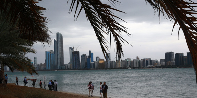 Tourists gather at Abu Dhabi sea front before a heavy rain storm on March 9, 2016.Schools in the United Arab Emirates were ordered to shut after rare heavy rain hit the desert Gulf state, causing flights to be suspended and flooding roads. / AFP / STRINGER        (Photo credit should read STRINGER/AFP/Getty Images)