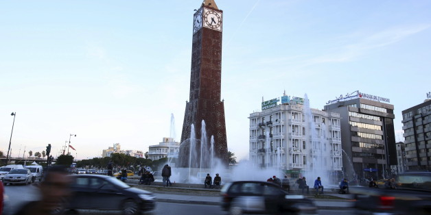 Cars pass by the obelisk clock tower at the end of Avenue Habib Bourguiba in Tunis, Tunisia, December 9, 2015. Picture taken December 9, 2015. REUTERS/Zoubeir Souissi