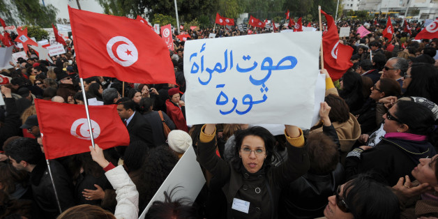 Tunisian women display placards during a protest on International Women's Day in Tunis on March 8, 2012. The legal status of women in Tunisia is unique in the Arab world giving strict equality between men and women since since 1956. AFP PHOTO / FETHI BELAID (Photo credit should read FETHI BELAID/AFP/Getty Images)