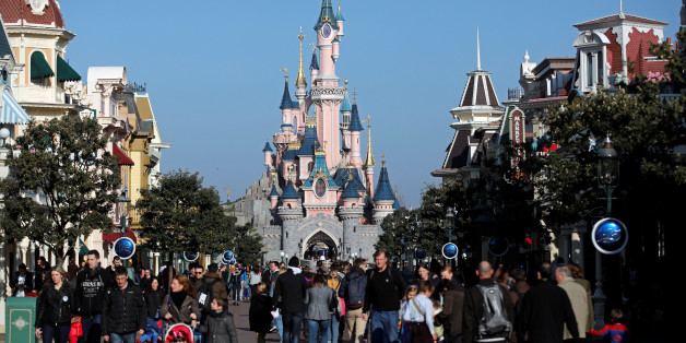 Visitors walk towards the Sleeping Beauty Castle in Disneyland Paris ahead of the 25th anniversary of the park in Marne-la-Vallee, near Paris, France, March 16, 2017. Picture taken March 16, 2017. REUTERS/Benoit Tessier