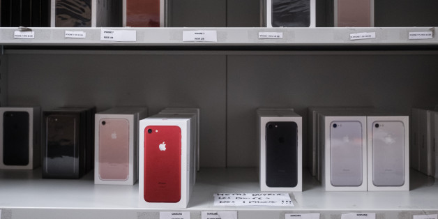 Boxes of Apple Inc. iPhone 7 smartphones sit at the storeroom inside an Orange SA mobile phone store in Blagnac near Toulouse, France, on Wednesday, July 26, 2017. Orange is looking for European acquisitions outside of telecommunications that could cost as much as several billion euros, and recently considered buying German metering company Ista International GmbH, according to people close to the matter. Photographer: Balint Porneczi/Bloomberg via Getty Images