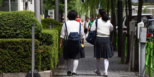 Japanese schoolgirls walk on a street in Tokyo on September 1, 2017.As Japan's schools reopened Friday after summer holidays, a day when suicides among young people spike, celebrities reached out to at-risk kids and one Tokyo zoo offered refuge to petrified pupils in a bid to tackle the mental health crisis. For some schoolkids, the thought of returning to school sends their stress levels soaring, as they battle fears ranging from schoolyard bullies to doing poorly on exams. / AFP PHOTO / Toru Y