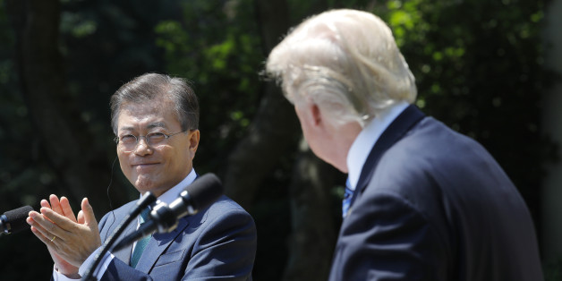 South Korean President Moon Jae-in (L) applauds next to U.S. President Donald Trump while delivering a joint statement from the Rose Garden of the White House in Washington, U.S., June 30, 2017. REUTERS/Carlos Barria