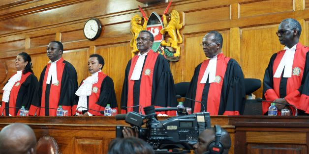 Judges stand to deliver their verdict at the Supreme Court in Nairobi on September 1, 2017, ordering a new presidential election within 60 days after cancelling after cancelling the results of last month's poll.  Kenya's Supreme Court nullified President Uhuru Kenyatta's election win last month and called for new elections within 60 days.  / AFP PHOTO / SIMON MAINA        (Photo credit should read SIMON MAINA/AFP/Getty Images)
