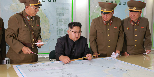 TOPSHOT - This picture taken on August 14, 2017 and released from North Korea's official Korean Central News Agency (KCNA) on August 15, 2017 shows North Korean leader Kim Jong-Un (C) inspecting the Command of the Strategic Force of the Korean People's Army (KPA) at an undisclosed location.