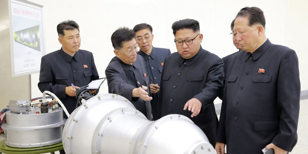 TOPSHOT - This undated picture released by North Korea's official Korean Central News Agency (KCNA) on September 3, 2017 shows North Korean leader Kim Jong-Un (C) looking at a metal casing with two bulges at an undisclosed location. North Korea has developed a hydrogen bomb which can be loaded into the country's new intercontinental ballistic missile, the official Korean Central News Agency claimed on September 3. Questions remain over whether nuclear-armed Pyongyang has successfully miniaturised its weapons, and whether it has a working H-bomb, but KCNA said that leader Kim Jong-Un had inspected such a device at the Nuclear Weapons Institute. / AFP PHOTO / KCNA VIA KNS / STR / South Korea OUT / REPUBLIC OF KOREA OUT   ---EDITORS NOTE--- RESTRICTED TO EDITORIAL USE - MANDATORY CREDIT 'AFP PHOTO/KCNA VIA KNS' - NO MARKETING NO ADVERTISING CAMPAIGNS - DISTRIBUTED AS A SERVICE TO CLIENTS THIS PICTURE WAS MADE AVAILABLE BY A THIRD PARTY. AFP CAN NOT INDEPENDENTLY VERIFY THE AUTHENTICITY, LOCATION, DATE AND CONTENT OF THIS IMAGE. THIS PHOTO IS DISTRIBUTED EXACTLY AS RECEIVED BY AFP.  /         (Photo credit should read STR/AFP/Getty Images)