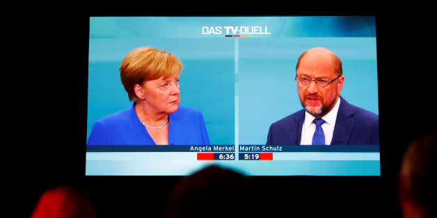Journalists watch a TV debate between German Chancellor Angela Merkel of the Christian Democratic Union (CDU) and her challenger Germany's Social Democratic Party SPD candidate for chancellor Martin Schulz in Berlin, Germany, September 3, 2017. German voters will take to the polls in a general election on September 24. REUTERS/Fabrizio Bensch