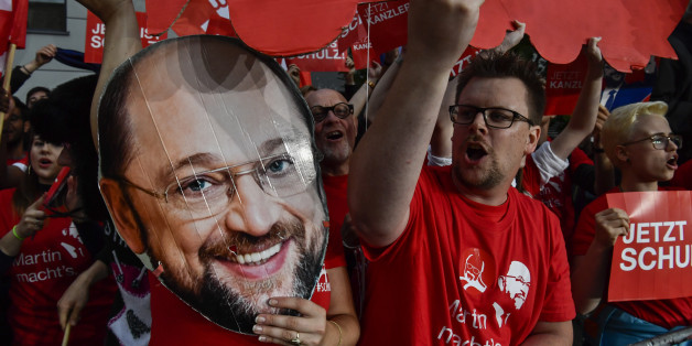 Supporters of Martin Schulz, leader of Germany's social democratic SPD party and chancellor candidate shout slogans after Schulz arrived for a televised debate at a television studio in Berlin on September 3, 2017.